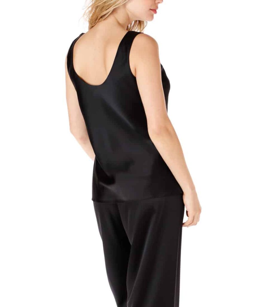 silk black camisole and lounge pant is worn by a women