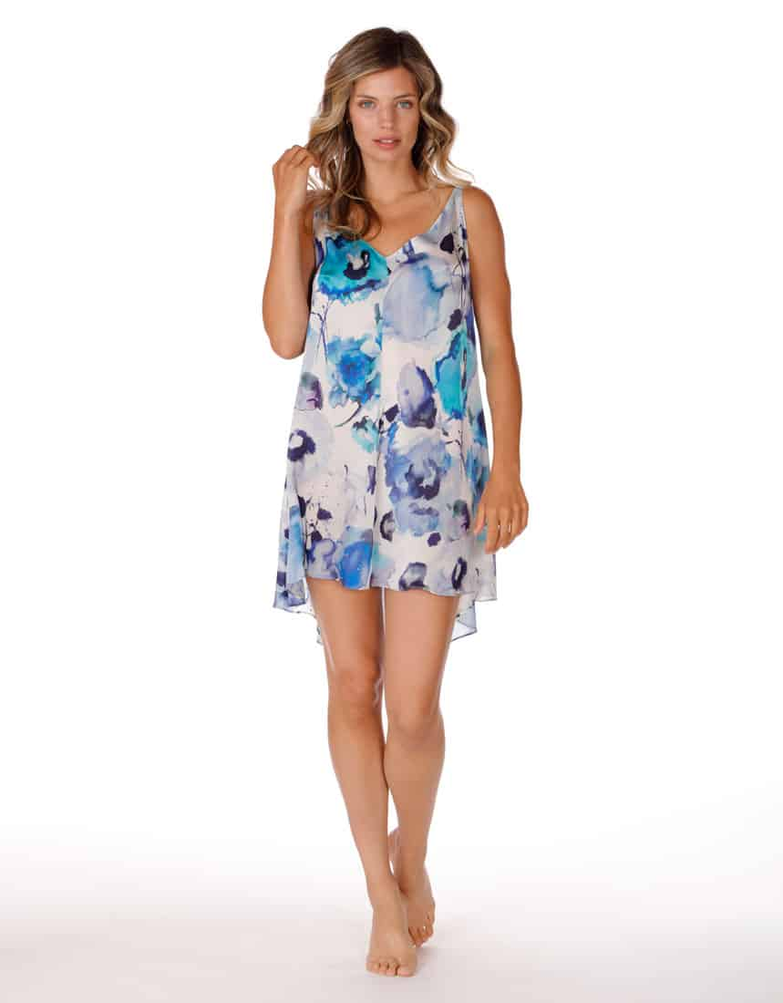 A silk loose chemise with our Christine Lingerie floral Adrift print is worn by a women