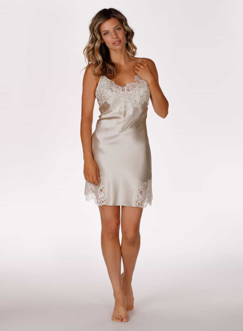A silk silver chemise with white lace is worn by a women