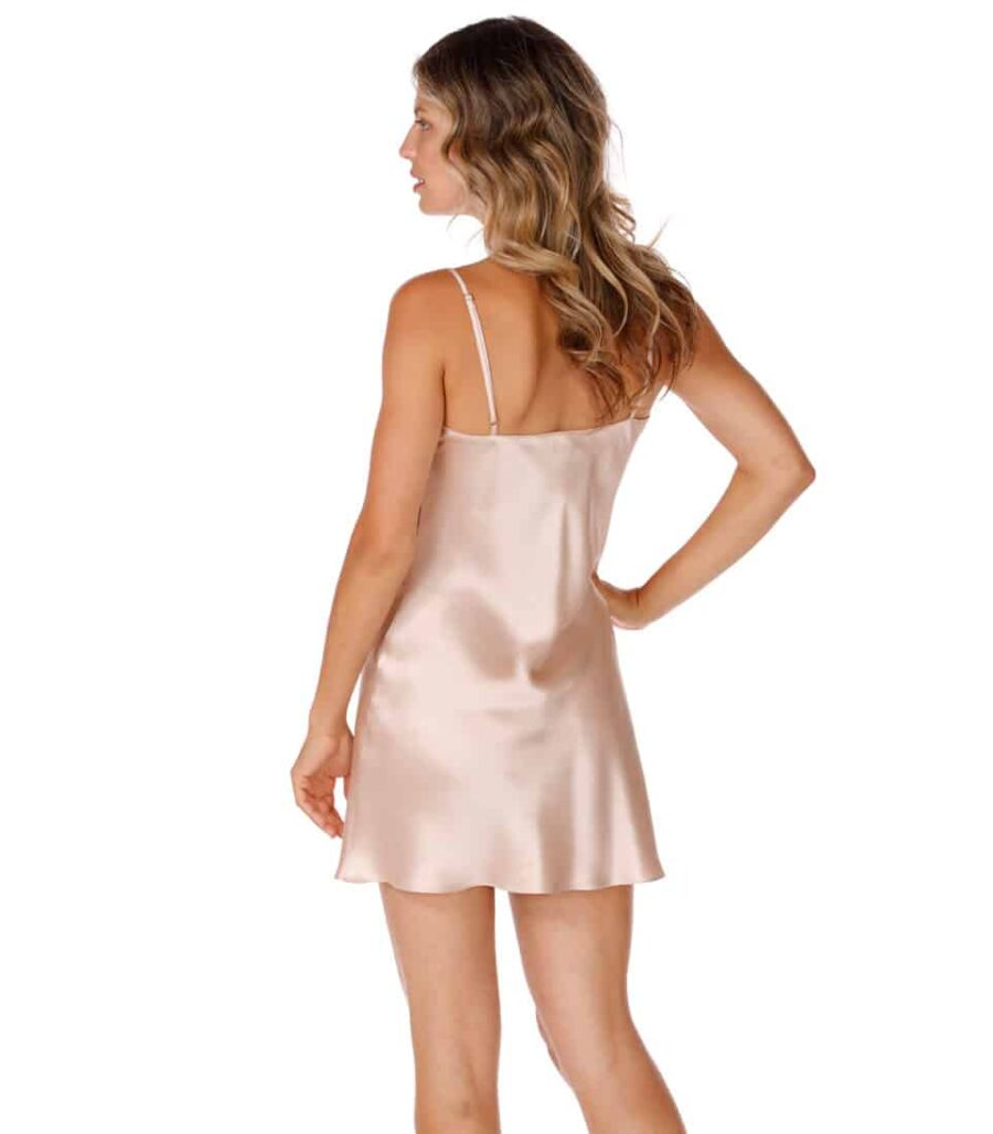 silk chemise is worn by women posed with back to camera with hand on hip