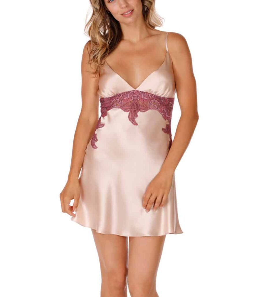silk pink chemise is worn by women in a pose