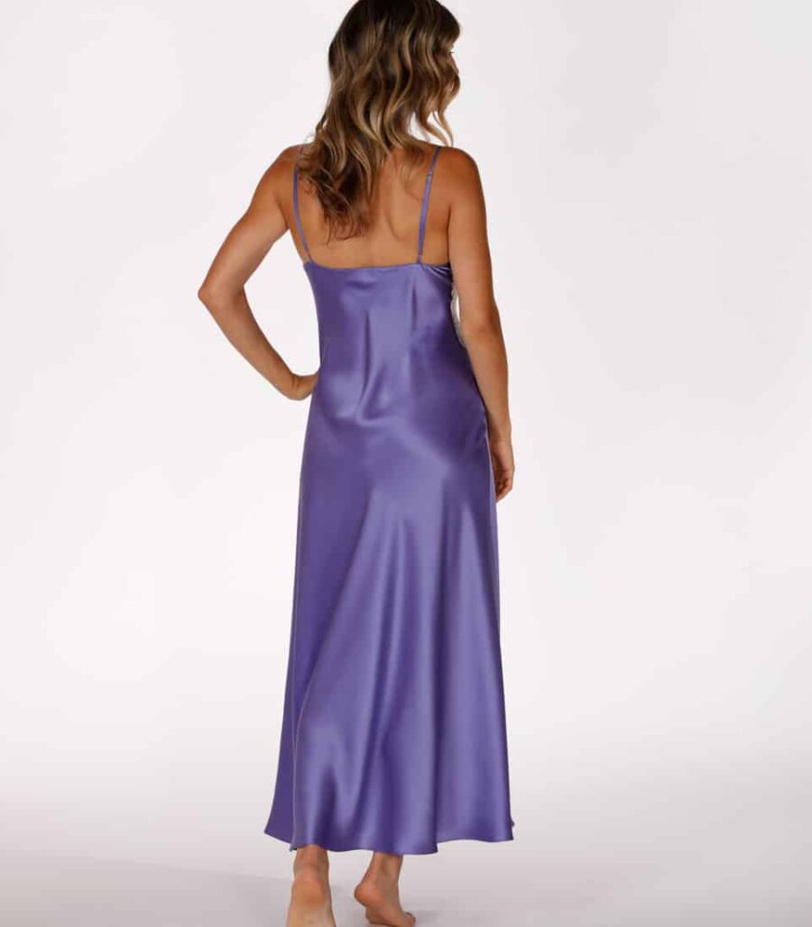 silk purple gown is worn by women posed with back to camera