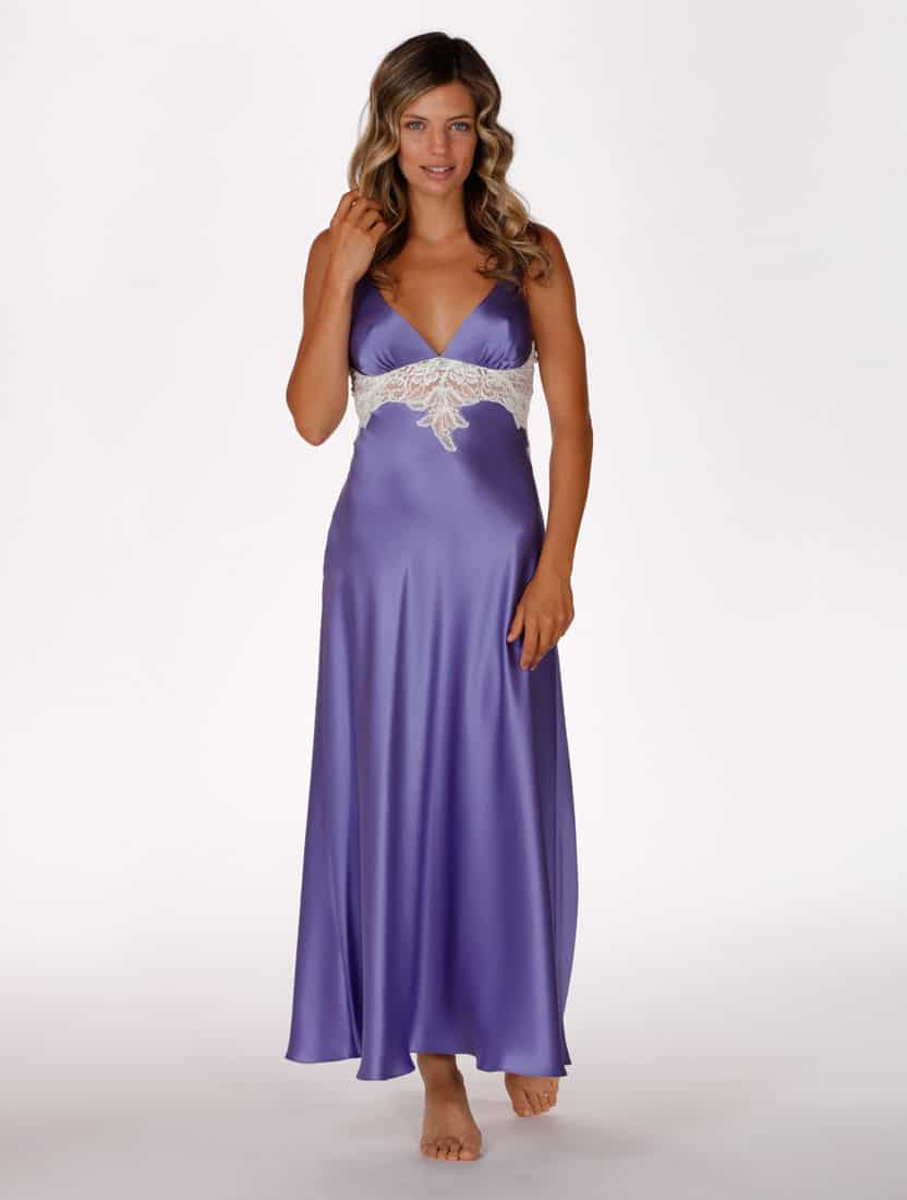 silk purple gown with lace is worn by women posed with hand in hair