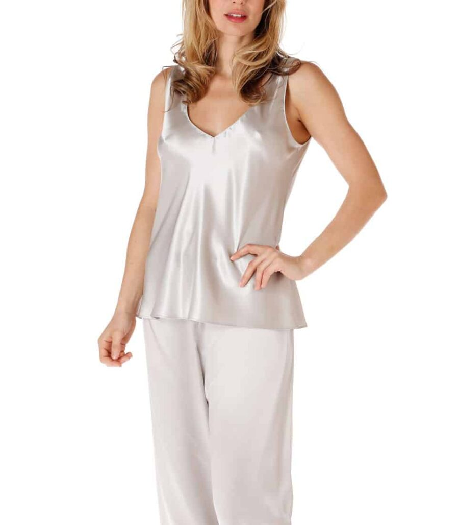 silk silver camisole and lounge pant is worn by a women
