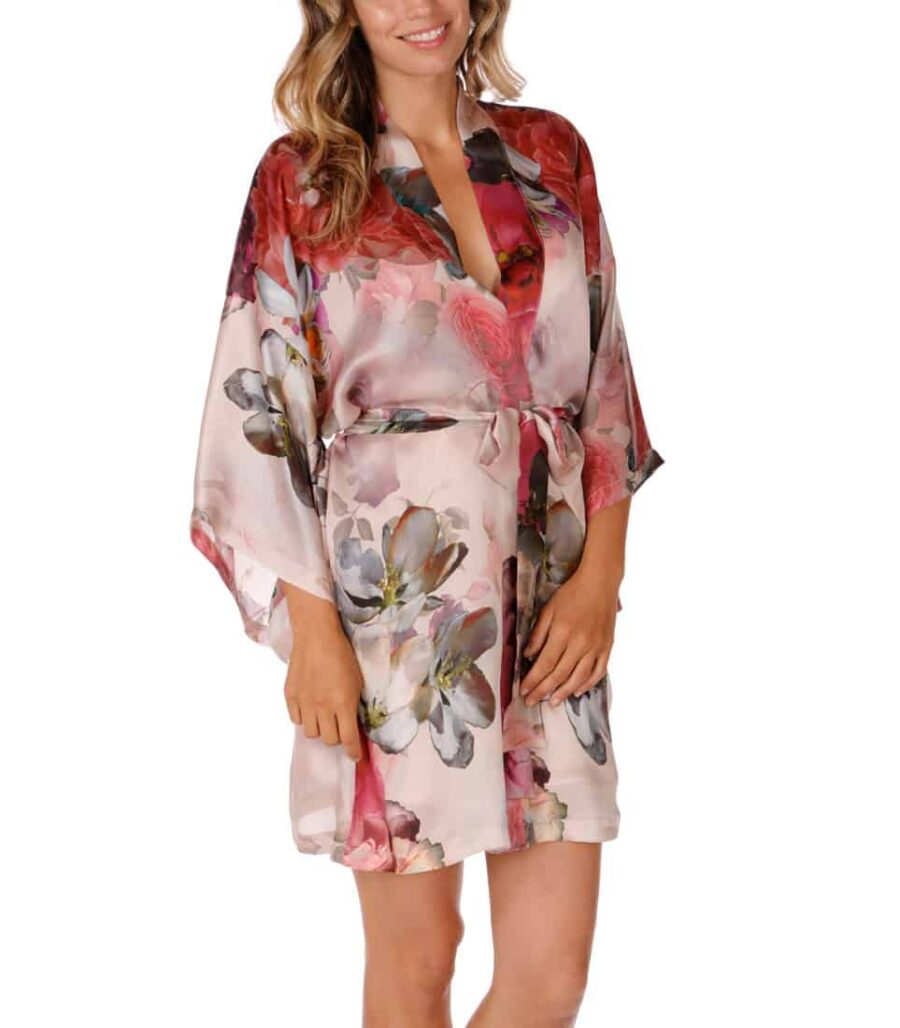 A silk short robe with our Christine Lingerie floral Camile print is worn by a women