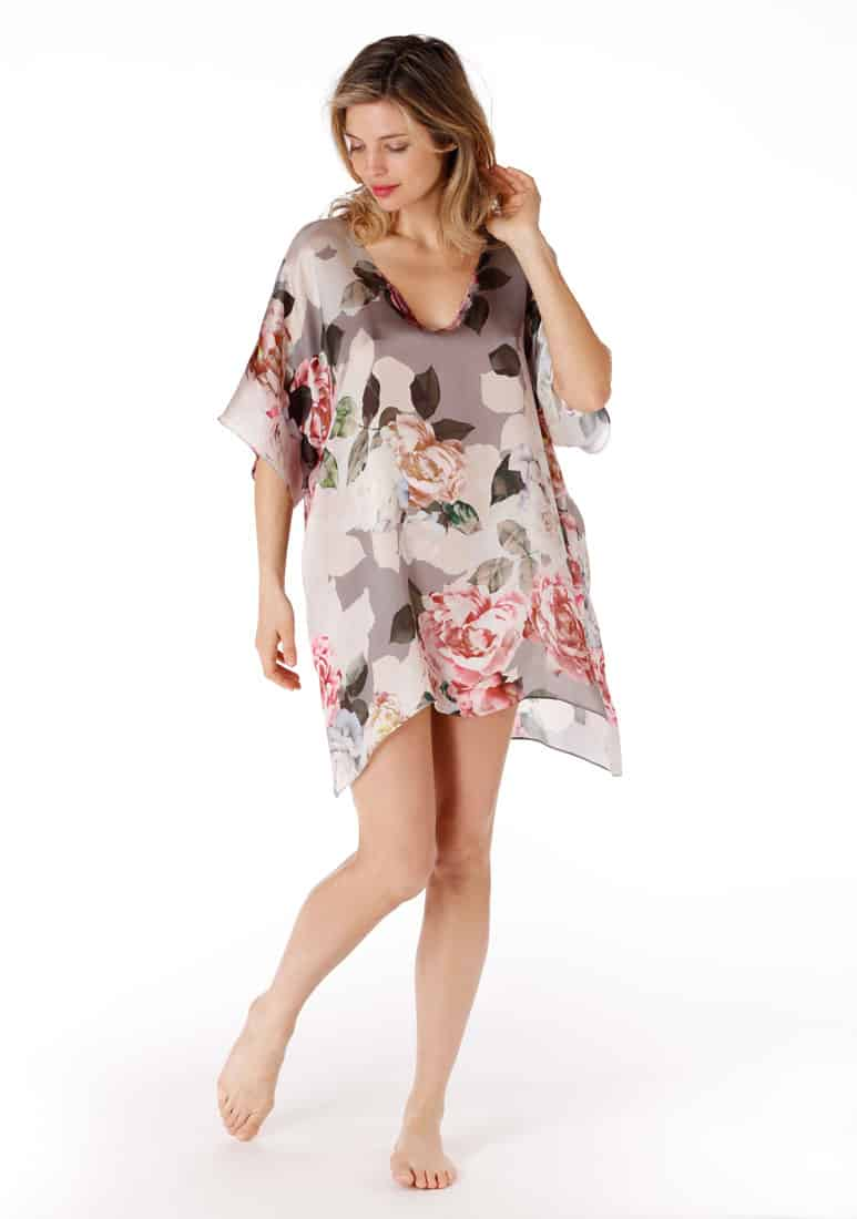 A silk tunic in our Christine Lingerie floral print is worn by a women
