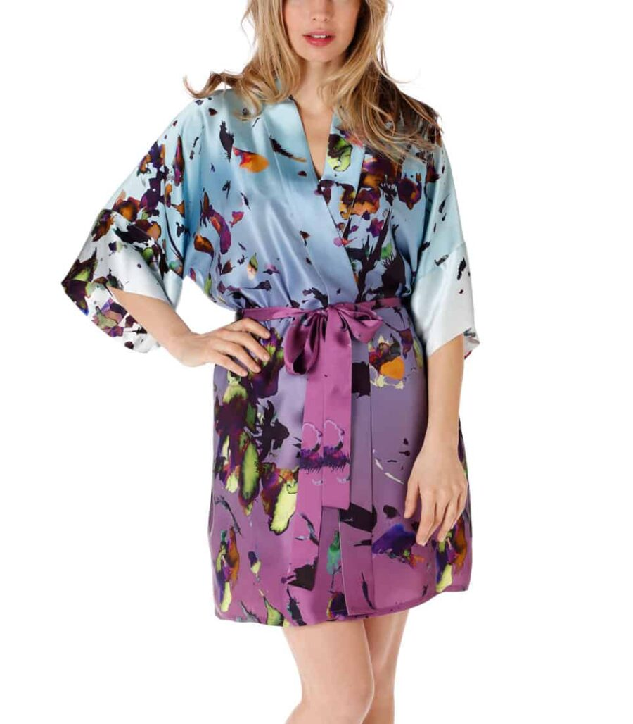 A silk short robe with our Christine Lingerie floral kaleidoscope print is worn by a women