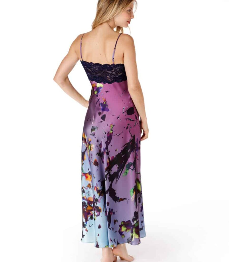 A silk nightgown with our Christine Lingerie floral kaleidescope print and purple lace is worn by a women