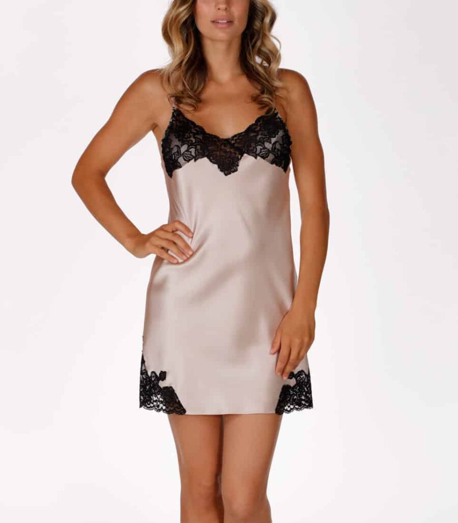 A silk pink chemise with lace is worn by a women