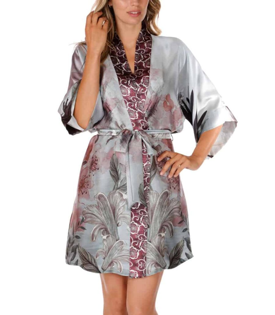 A silk short robe with our Christine Lingerie floral Solitude print is worn by a women