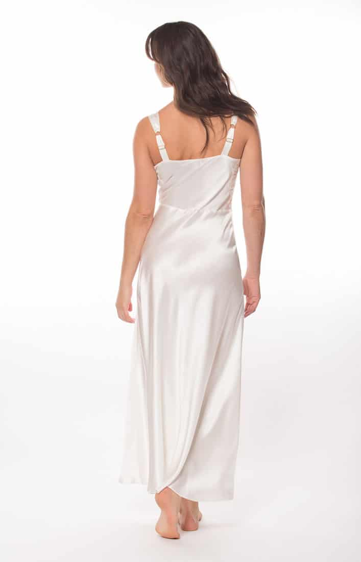 A white silk gown is worn by a women