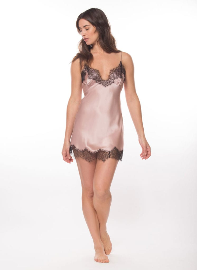 silk pink chemise with black lace is worn by a women