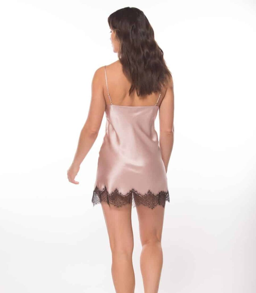 silk pink chemise with black lace is worn by women
