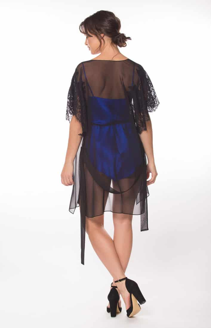 black silk chiffon short robe with black lace and a blue silk romper with black lace is worn by a women