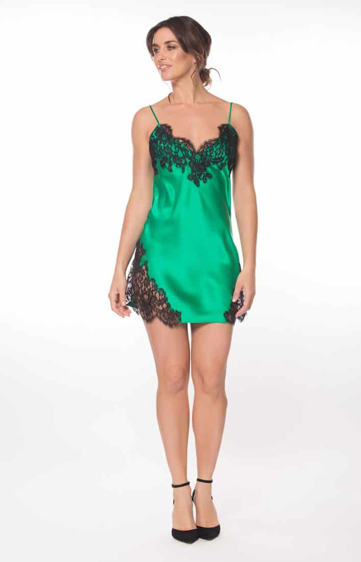 silk green chemise with black lace is worn by a women