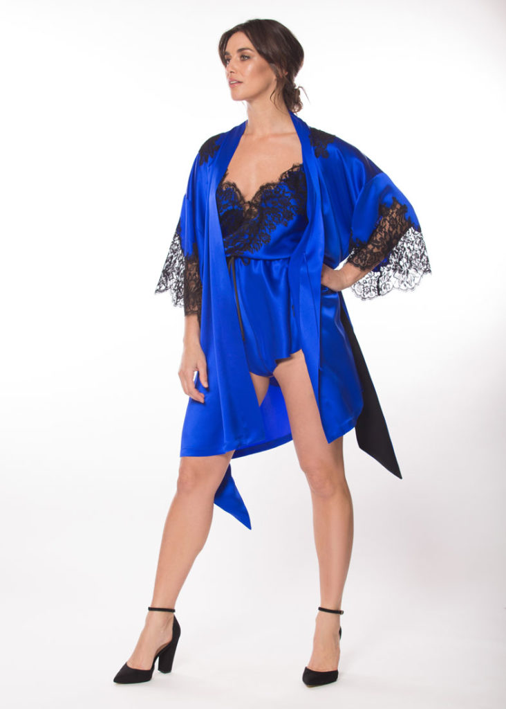 silk blue short robe with black lace is worn by a women