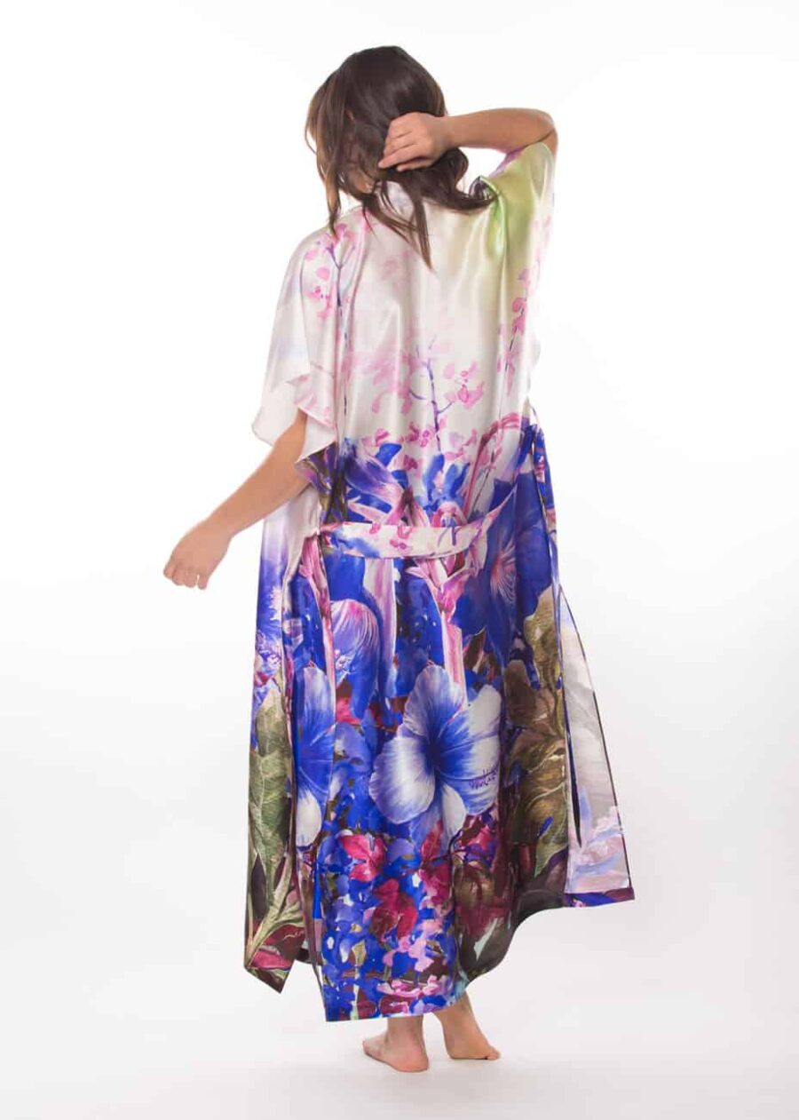 silk multi coloured print robe is worn by a women