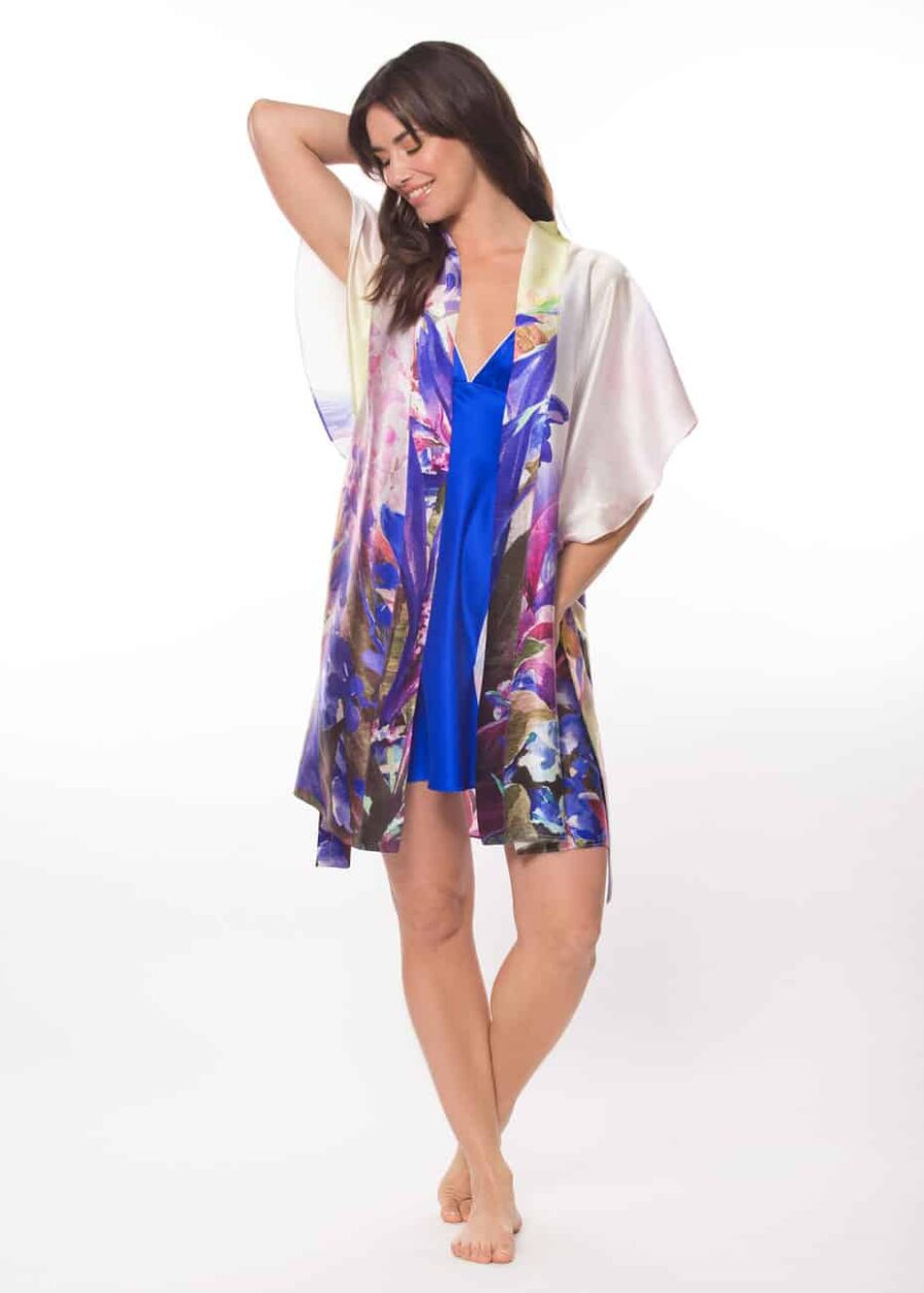 silk multi coloured short robe and a blue silk chemise is worn by a women