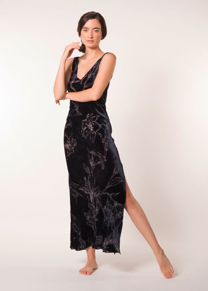 velvet midnight and print gown is worn by a women