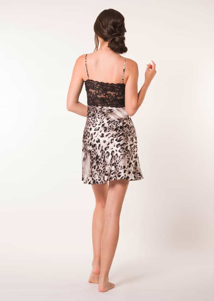 A silk chemise with a black lace bust in our Christine Lingerie leopard Femme Fatale print is worn by a women