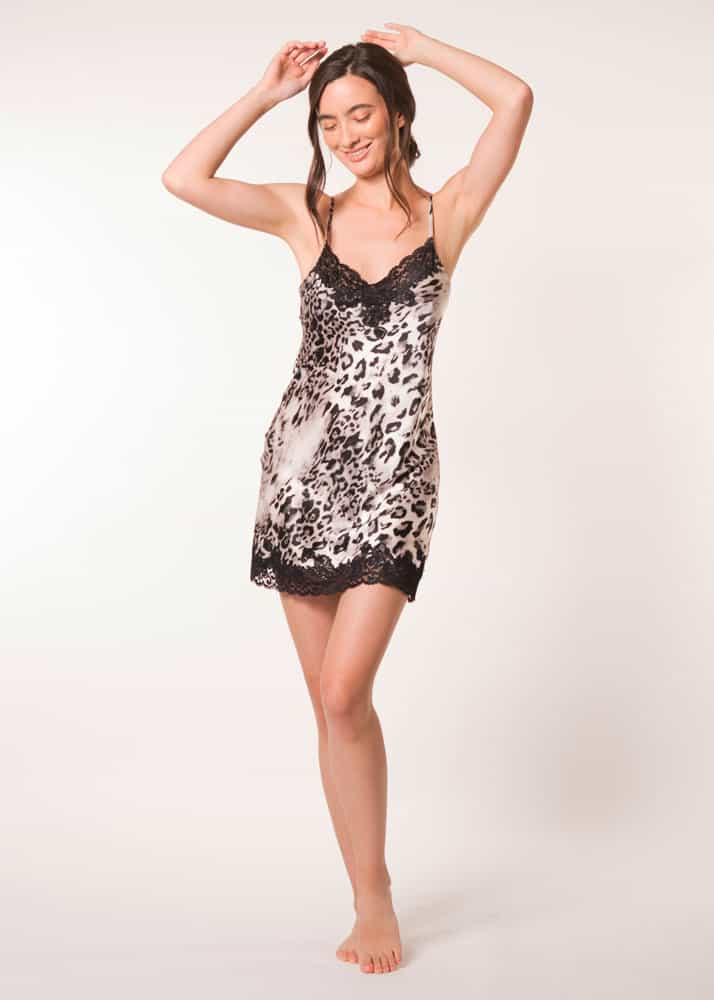 A silk chemise with black lace in our Christine Lingerie leopard Femme Fatale print is worn by a women