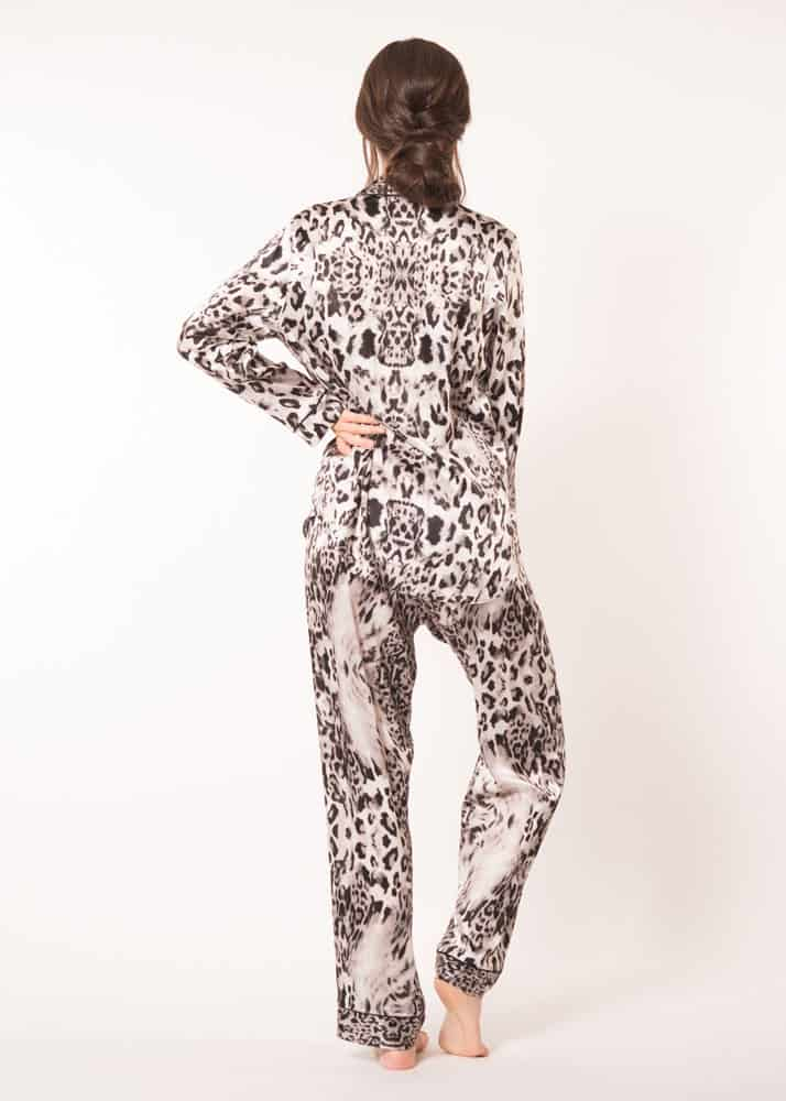 A silk pajama set with our Christine Lingerie leopard Femme Fatale print is worn by a women