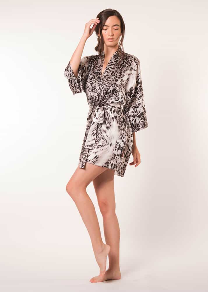 A silk short robe in our Christine Lingerie leopard Femme Fatale print is worn by a women