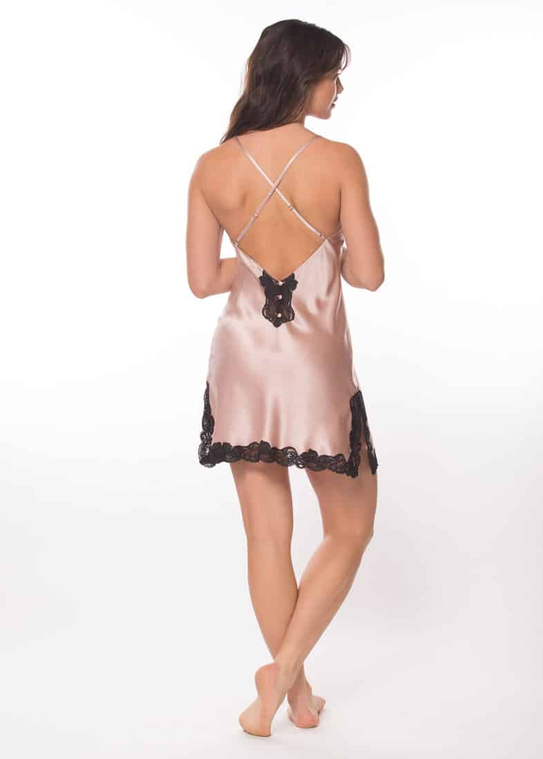A silk pink chemise with black lace is worn by a women