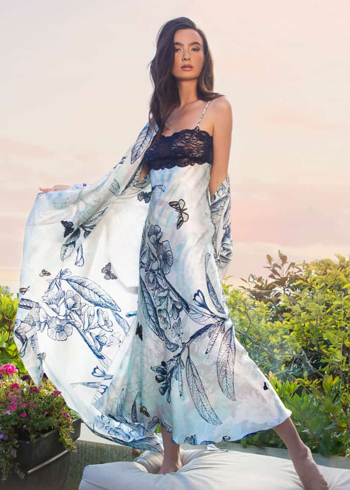 A silk gown with our Christine Lingerie floral Botanica print with midnight lace is paired with a silk long robe in the same print is worn by a women