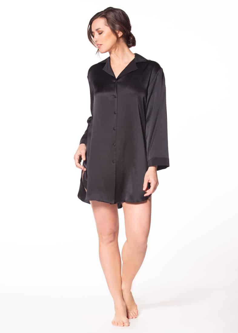 A black silk night shirt is being worn by a women