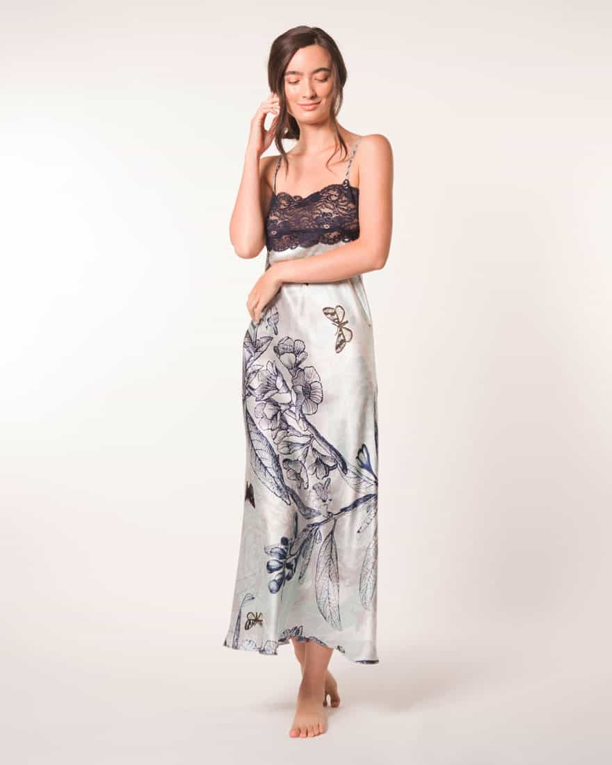 A silk gown with blue lace in our Christine Lingerie floral Botanica print is worn by a women