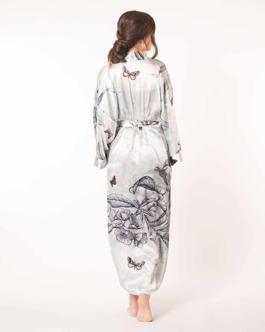 A silk long robe in our Christine Lingerie floral Botanica print is worn by a women