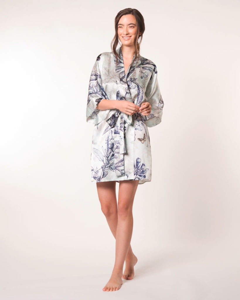 A silk short robe in our Christine Lingerie floral Botanica print is worn by a women